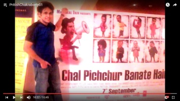 "Chakraborty Pritish holding his feature film 'Chal Pichchur Banate Hain"" six sheeter at theater in Mumbai"